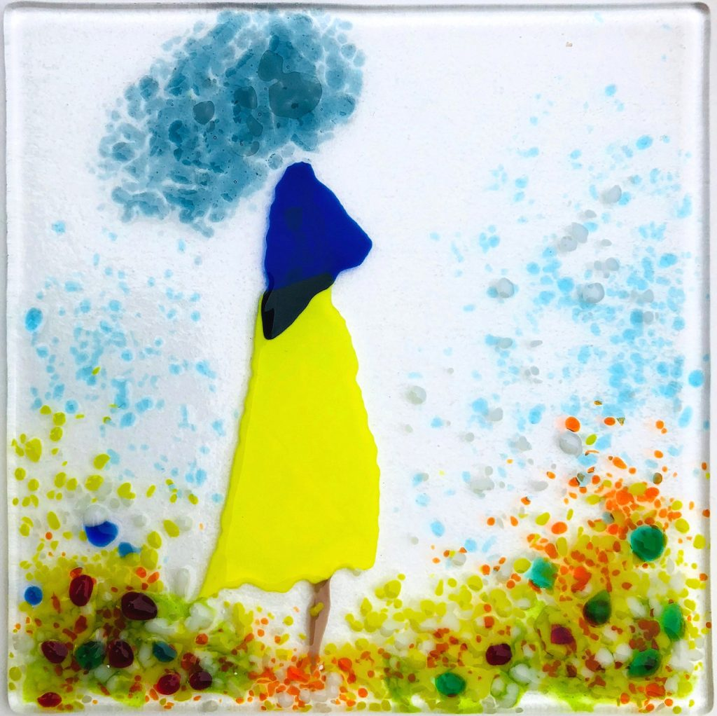 Girl in colourful meadow, dreaming